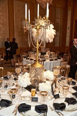 Wedding reception vintage deco inspired crystals gold candelabra centerpiece tall arrangement