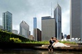 Bride and groom wading in Lake Michigan