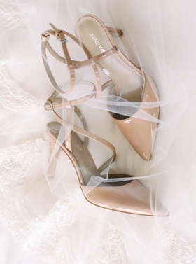 Wedding detail shot nude pumps ankle strap with white veil by Renee Pawele
