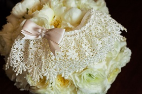 Lace wedding day garter white with dusty rose blush millennial pink bow in front