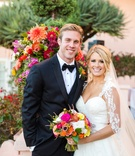 newlyweds posing colorful vibrant bouquet la jolla wedding veil tuxedo la valenica hotel cute couple