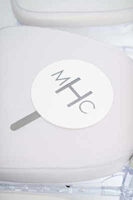 Round white and glitter paper fan on chair