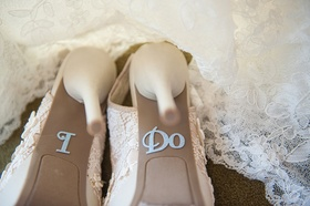 Bottom of wedding shoes with I Do sparkly silver wedding decals