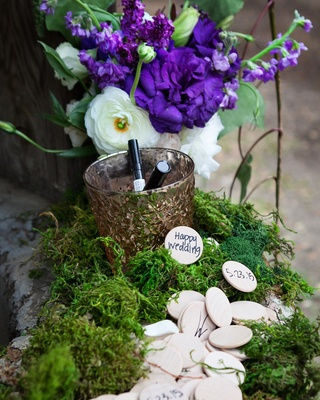 Wishing well with wood coins at an outdoor wedding at Oak Canyon Ranch, Agoura, CA