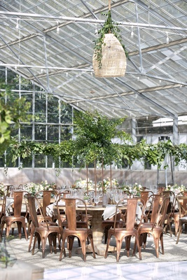 wedding reception greenhouse venue woven lantern pendant pedestal table industrial copper chairs