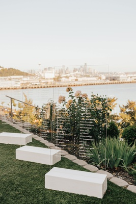 acrylic lucite seating chart for wedding in front of view puget sound seattle skyline