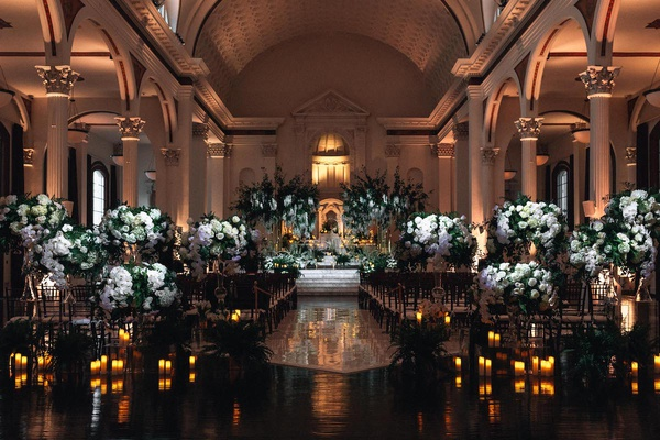 indoor wedding ceremony at vibiana, white flowers and greenery at ceremony