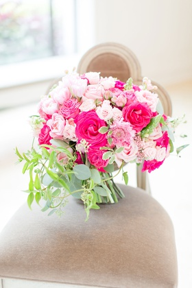 wedding bouquet on chair greenery hot pink rose light pink rose flowers
