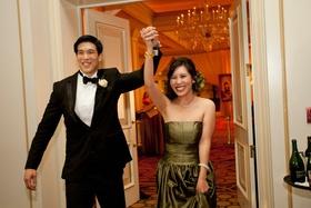 Bride and groom entering ballroom reception