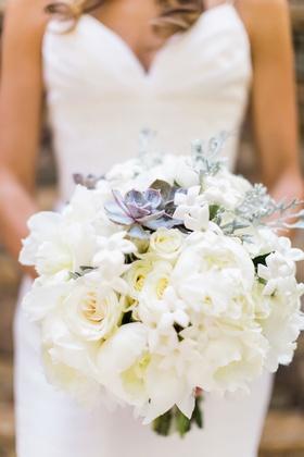 Bride holding white bouquet peony rose stephanotis blossom greenery succulent purple green