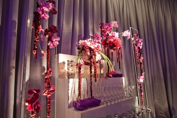 White staircase with purple flowers and champagne glasses