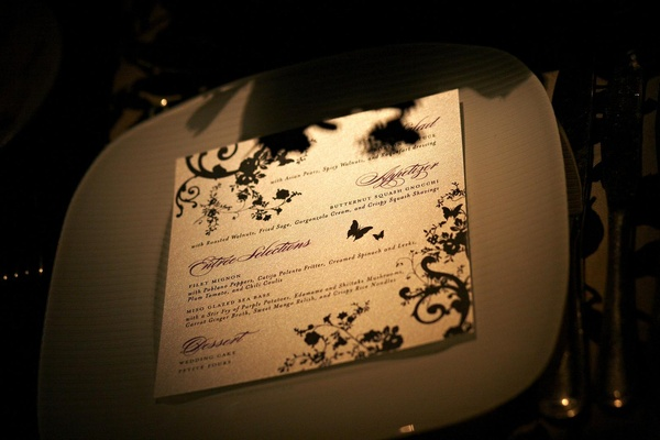 white menu with black butterfly and vine design
