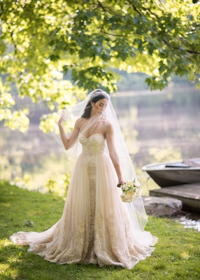 Mark Ingram champagne gown with gold embroidery and blusher veil