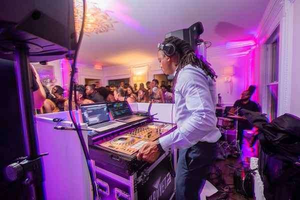 purple uplighting, wedding reception entertainment idea, dj and live drummer