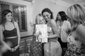 Black and white photo of bride to be hugging guest at bridal shower