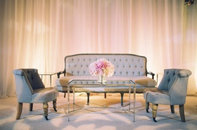 Tufted accent chairs and loveseat at wedding reception
