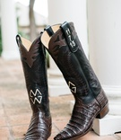 black and brown monogrammed cowboy boots with wedding date