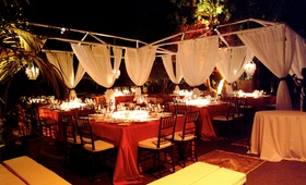 Scarlet tablecloths on tables and billowing drapery
