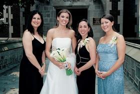 Woman in wedding dress with girlfriends