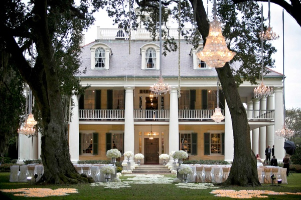 Outdoor wedding ceremony with chandeliers hanging from trees at Houmas House Plantation in Louisiana