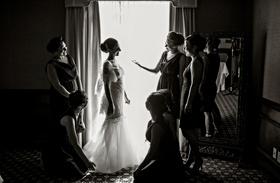 bride in Marchesa bridal gown getting dressed