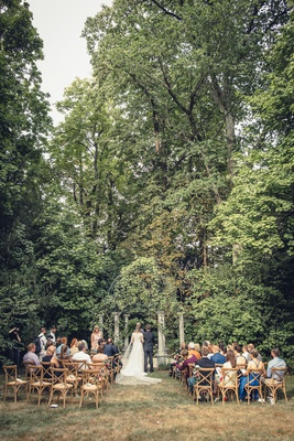 wedding guests at wood vineyard chairs garden outdoor ceremony france trees grass lawn