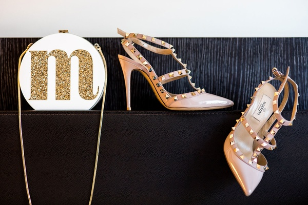 M Glitter initial on white bag with gold chain and nude Valentino shoes with studs wedding day