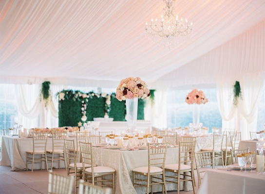 Lovely country club summer wedding with tent reception in ohio wedding reception green hedge wall flowers tall centerpieces gold chairs reception decor ideas junglespirit Images