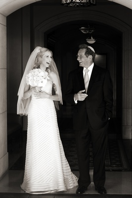 Black and white photo of bride smiling with father of bride