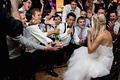 Male guests sing to bride in a Romona Keveza strapless gown