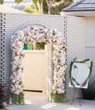 floral archway entrance to wedding reception, blush and ivory roses