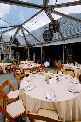 Reception tent with string lights and wicker lanterns