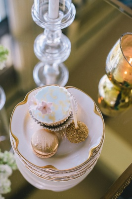 Wedding reception desserts of cupcake, macaron, and cake pop with golden sugar