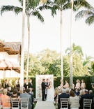 Garden wedding ceremony with a frame of flowers at the altar