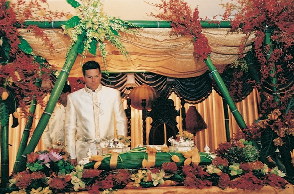 Groom stands at altar of traditional Cambodia ceremony