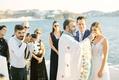 greek orthodox wedding ceremony at aegean sea view church in mykonos greece