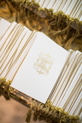 wedding ceremony programs white gold monogram gold tassel on spine glass mirror table