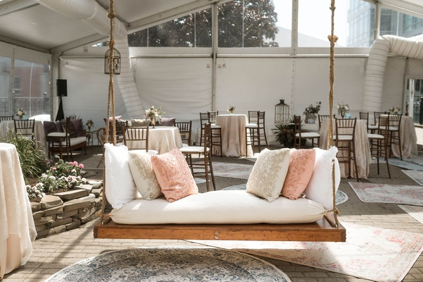 wedding reception tent lounge area wood daybed swing vintage area rugs