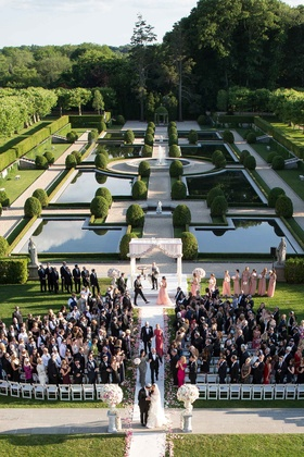 Wedding recessional on grounds of Oheka Castle in Huntington, New York