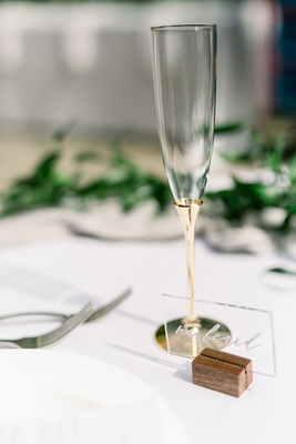 acrylic wedding place card in wood stand, champagne flute with gold stem
