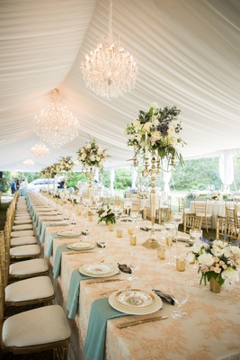 blush and white linens, blue napkins, tented reception, chandelier, gold chiavari chairs