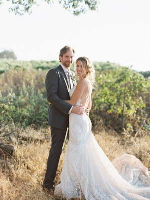 bride groom winery setting sonoma california wedding berta gown suit vineyard rustic