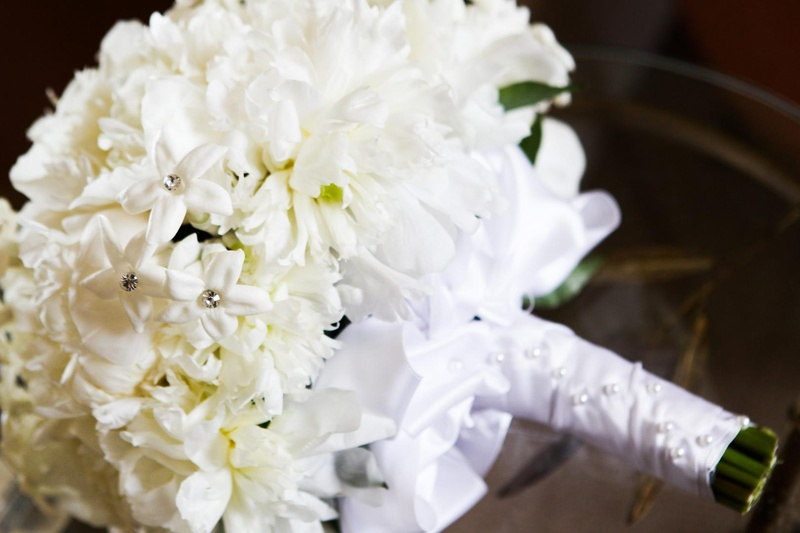 bouquet of white peonies and stephanotis blossoms