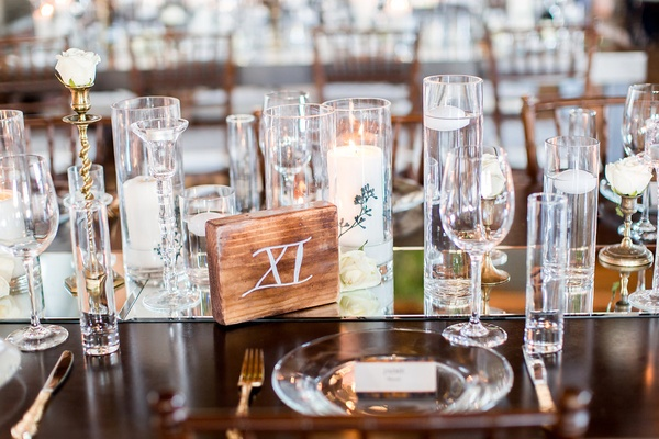 Wedding reception wood table with mirror runner candles wood block table number roman numeral