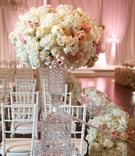 White hydrangea, white rose, pink rose, on crystal vase on mirror riser at entrance to ceremony