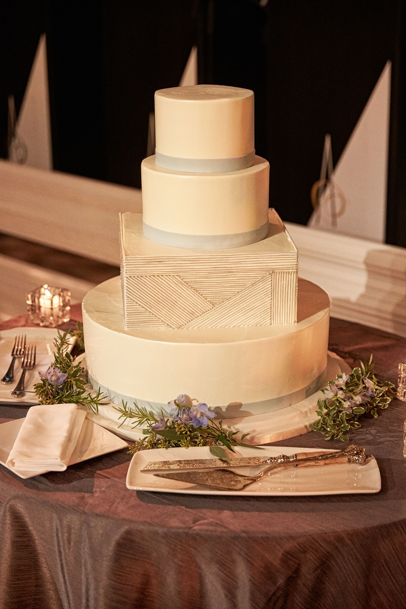 Wedding reception four layer wedding cake three round tiers one square tier geometric design silver