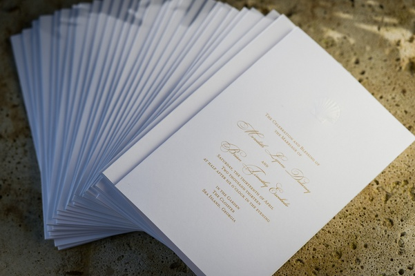White ceremony booklets with seashell motif