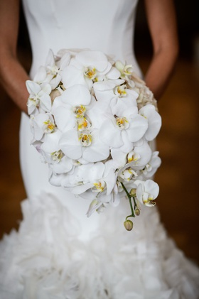bride in mermaid ines di santo wedding dress holding bouquet of white phalaenopsis orchids yellow