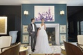 inspirational wedding, groom in grey tuxedo, bride in monique lhuillier v-neck gown tulle overskirt