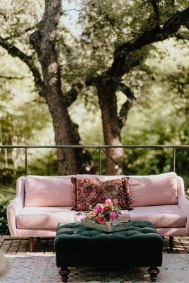 wedding reception lounge furniture emerald green tufted ottoman layered rug pink sofa vintage